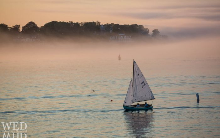 Two sailors finding their way in the fog on a Summer evening in Marblehead