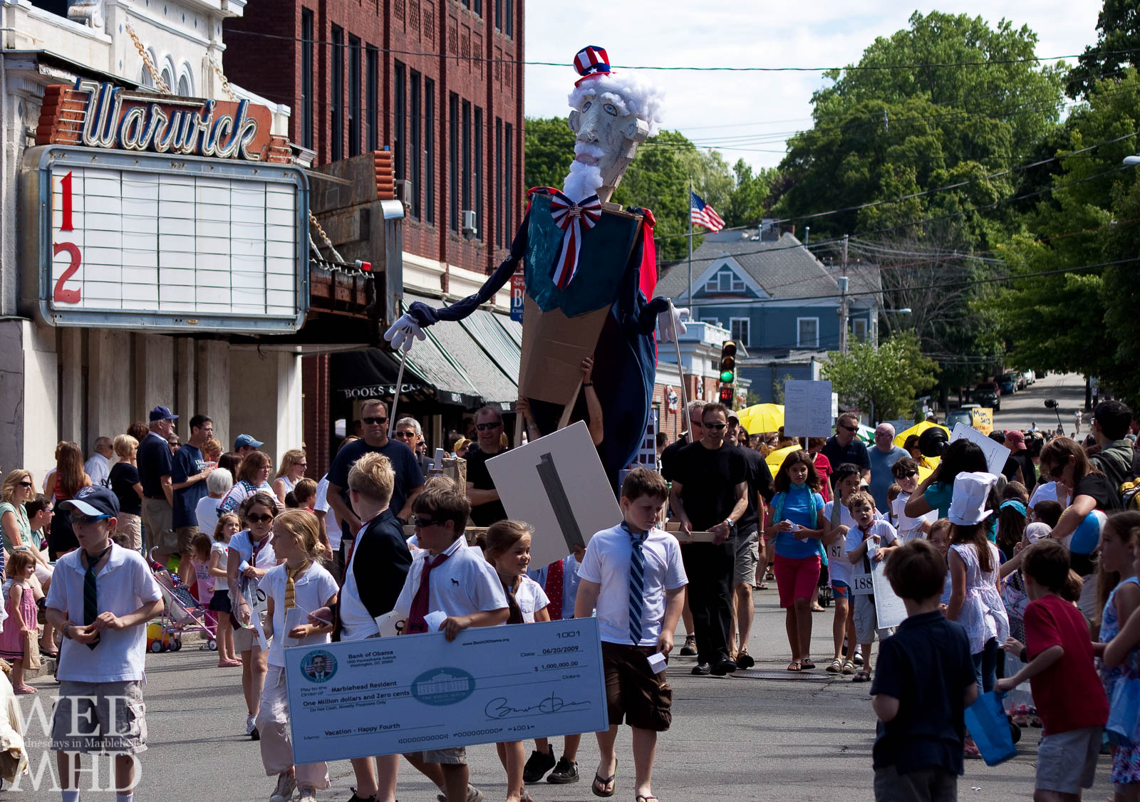 Kids take part in the Parade of Horribles along Pleasant Street in Marblehead