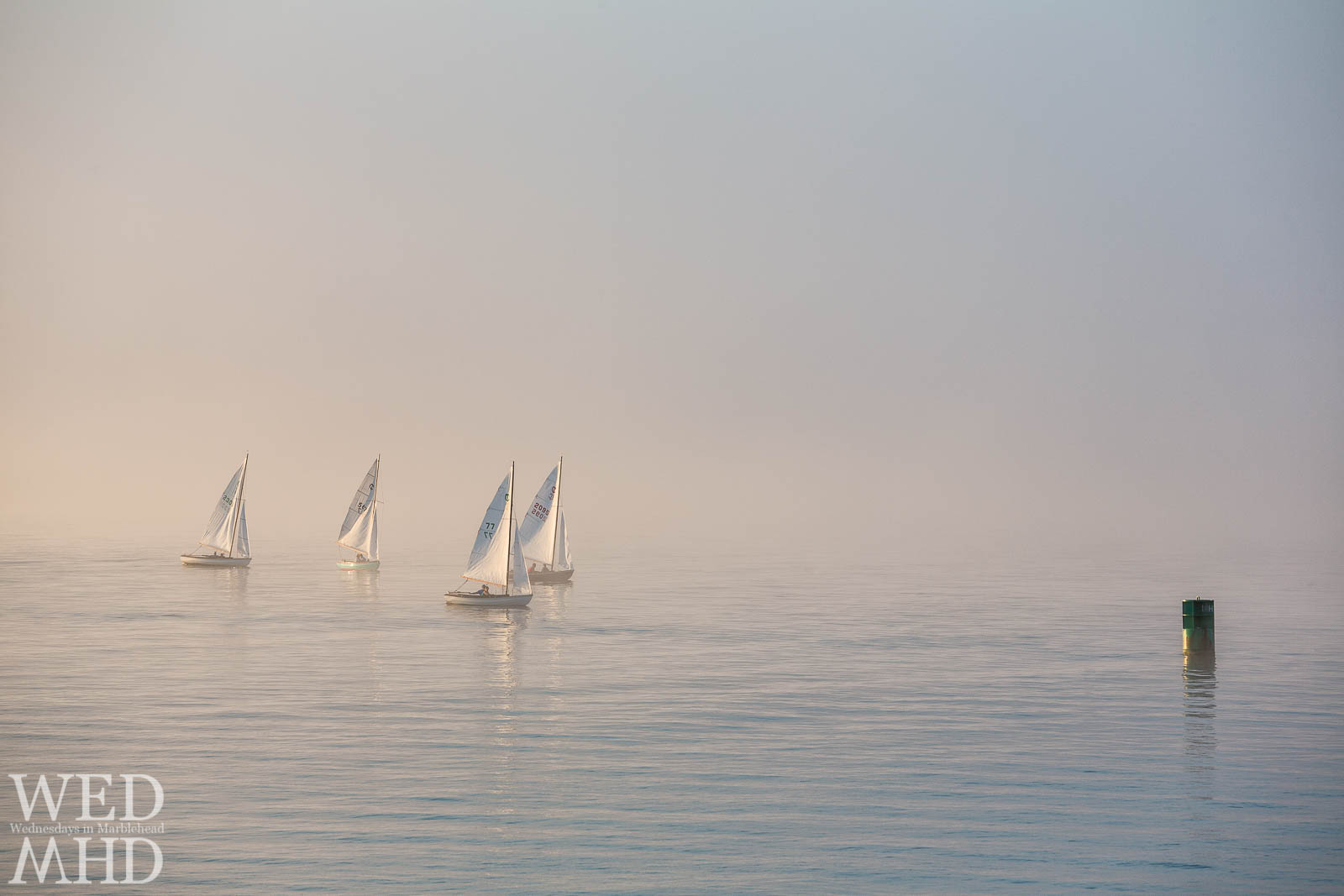 Fine art photograph of town class boats racing toward the MH1 marker in Marblehead Harbor