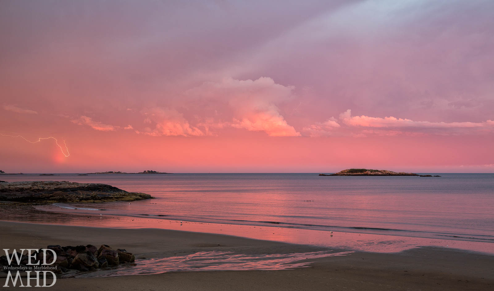 Rainbow lightning on a pink sky at Preston Beach in Marblehead