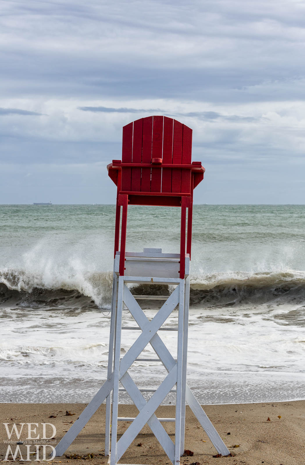 As a storm makes its way up the East coast, I'm reminded of this view of churning waves and the lifeguard chair from early September