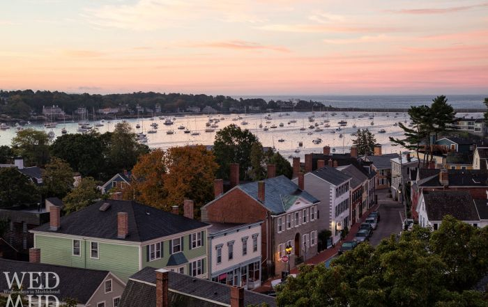 A view from atop St. Michaels Church reveals a sleepy downtown Marblehead with Hooper street and the harbor below bathed in morning color.