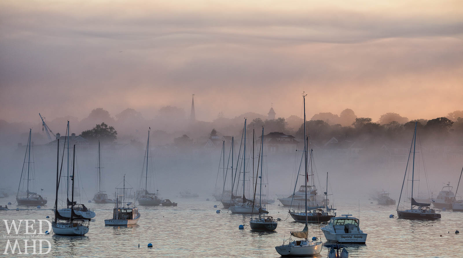 Marblehead's skyline is transformed by thick fog so that masts and steeples become the only familiar landmarks
