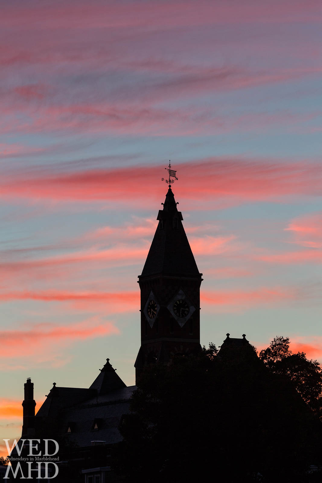 Abbot Hall captured in this sunset silhouette with wispy clouds reflecting the colors of sunset