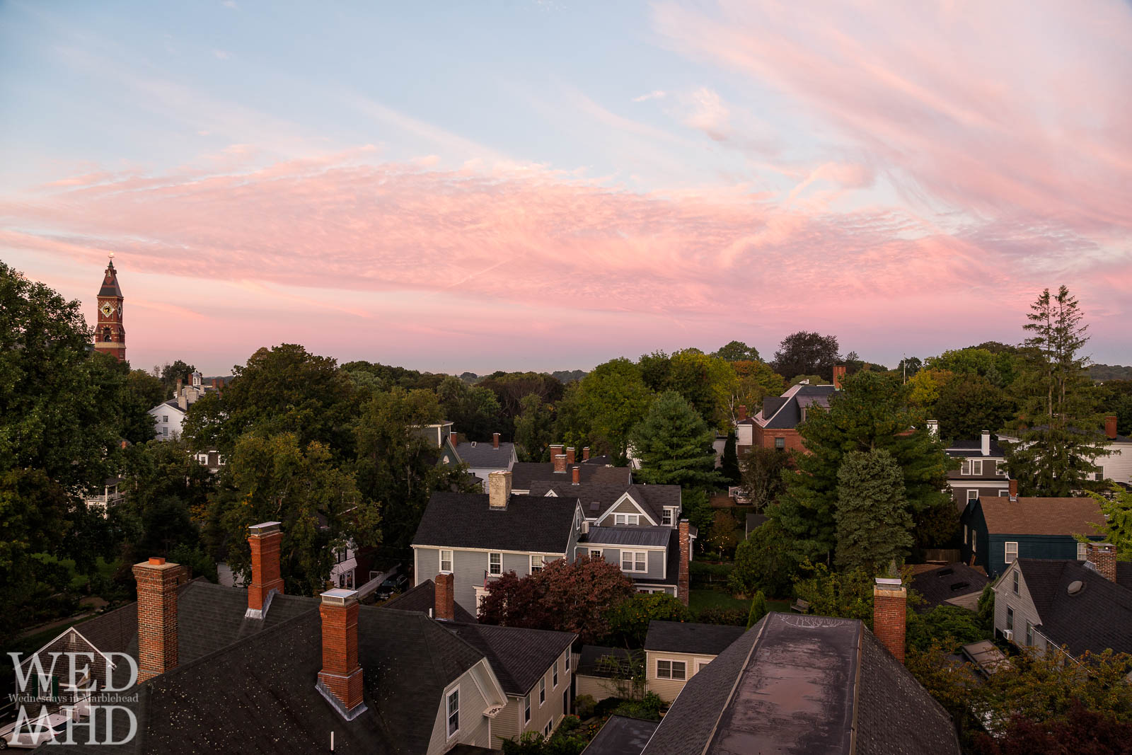 A view of Abbot and the rooftops from atop St. Michael's steeple at dawn in early October