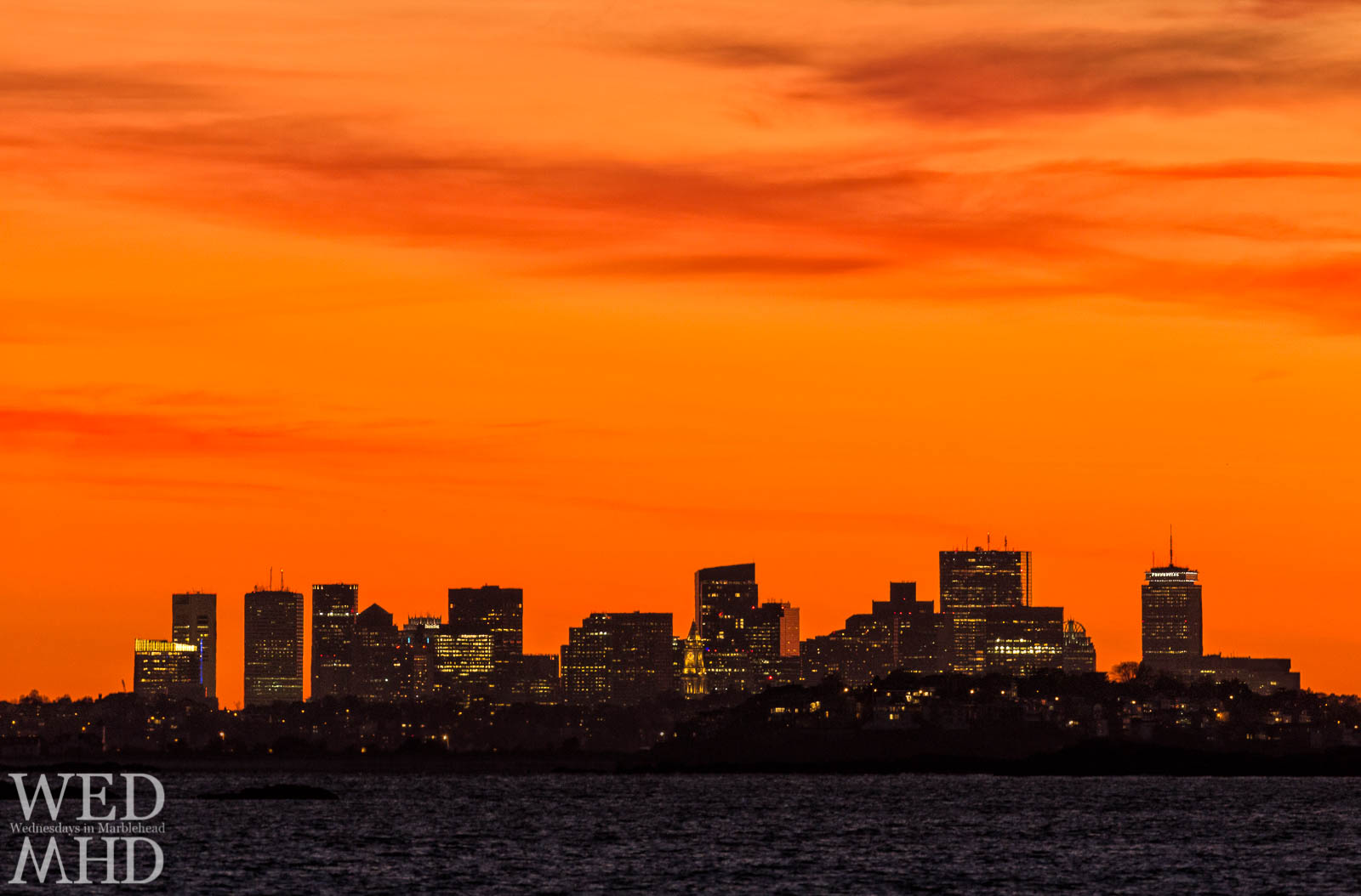 A view of Boston skyline from Marblehead at sunset. Despite being 15 miles away, on a clear night, the buildings can easily be seen from the North Shore.