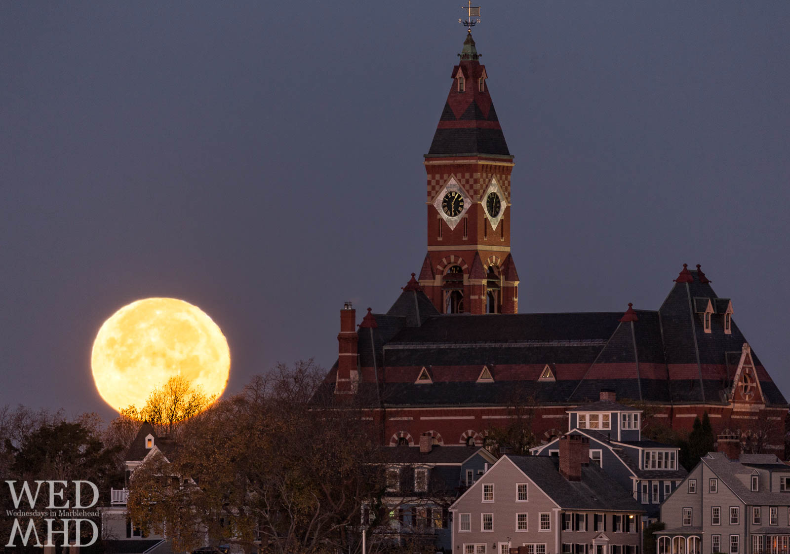 As dawn breaks over Marblehead the setting moon descends against Abbot Hall.  This months supermoon was the largest moon in over 60 years.