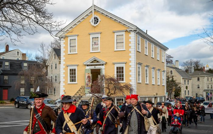 Glover's Regiment leads the annual Marblehead Christmas Walk Parade along Washington Street past Old Town House