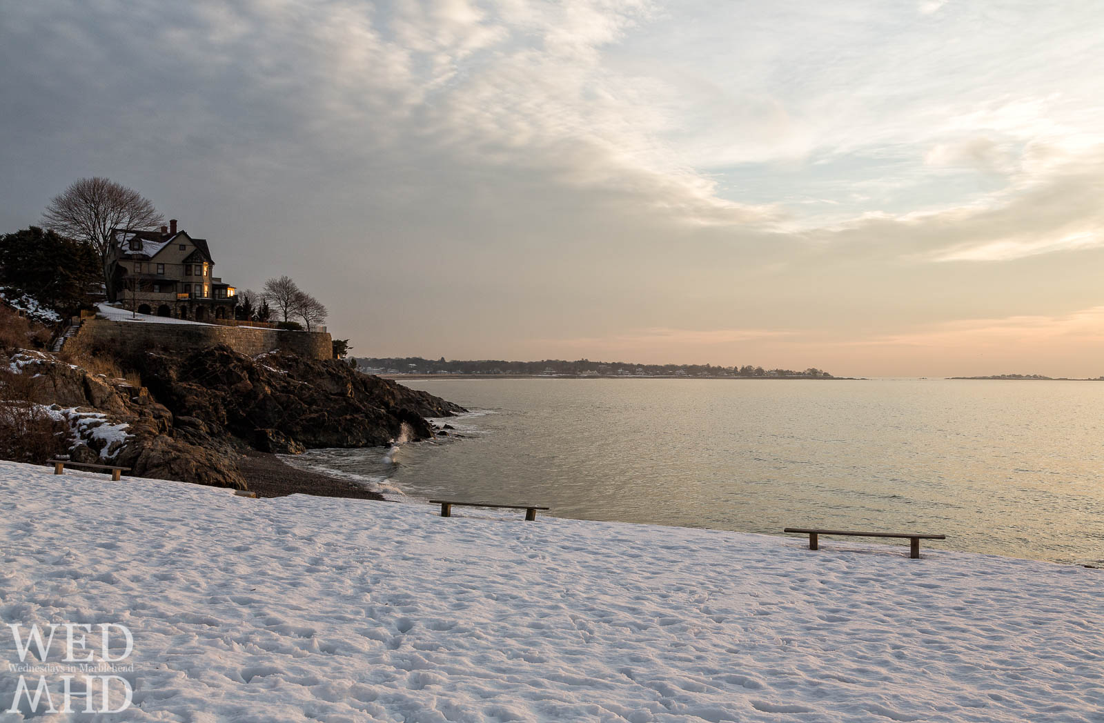 A view of Greystone beach after a snow storm cleared overnight results in a beautiful dawn with soft light of sunrise