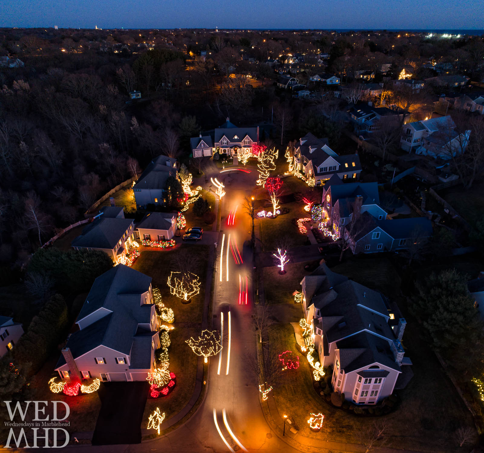 Cars drive down Riverside Drive to view the best holiday light display in Marblehead as every home participates in an annual tradition