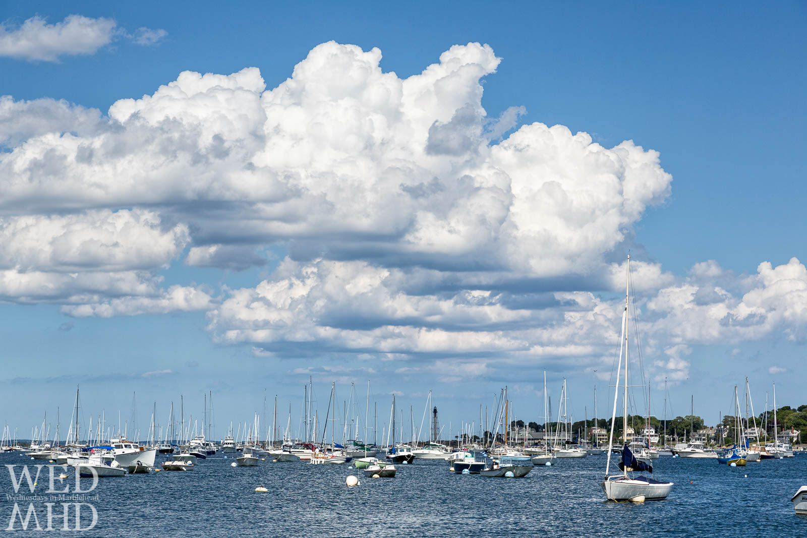The warmth of Summer in Marblehead is captured with the clouds in the sky and boats in the harbor on this early August afternoon