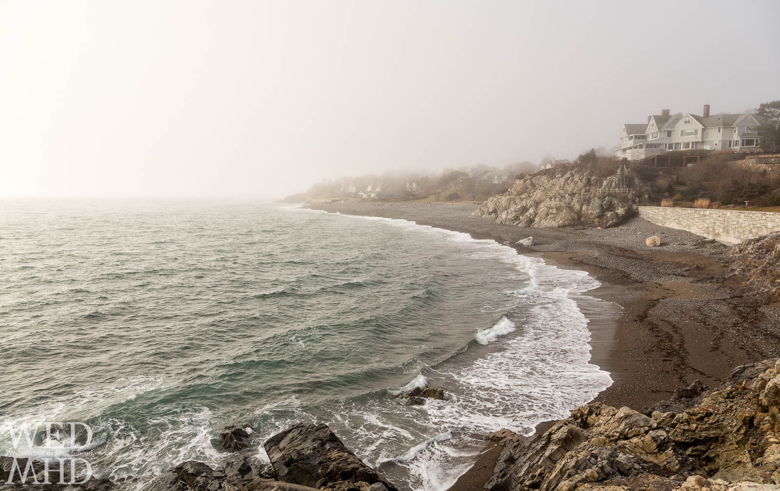 A view of the coastline in the fog along Marblehead Neck as seen from Castle Rock on a beautiful February morning. Perfect wave form formed along the beach.