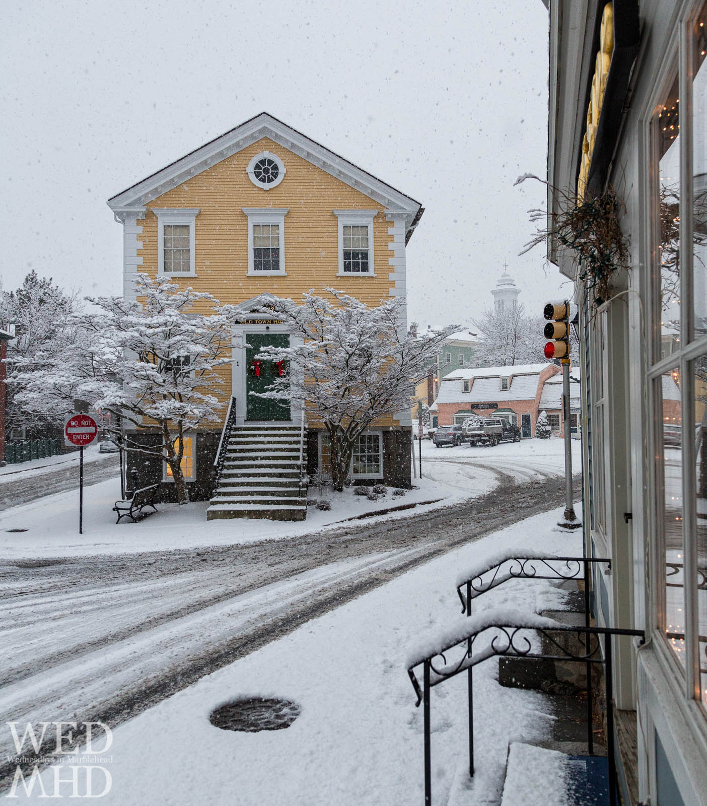 Falling snow surrounds Old Town House creating a picturesque view of historic downtown Marblehead