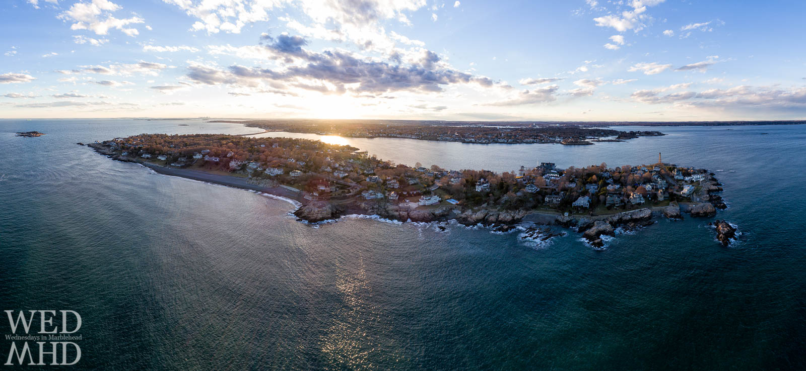 Tonight's sunset reflects as a golden glow on Marblehead Harbor in this panoramic view of Marblehead Neck from four hundred feet up