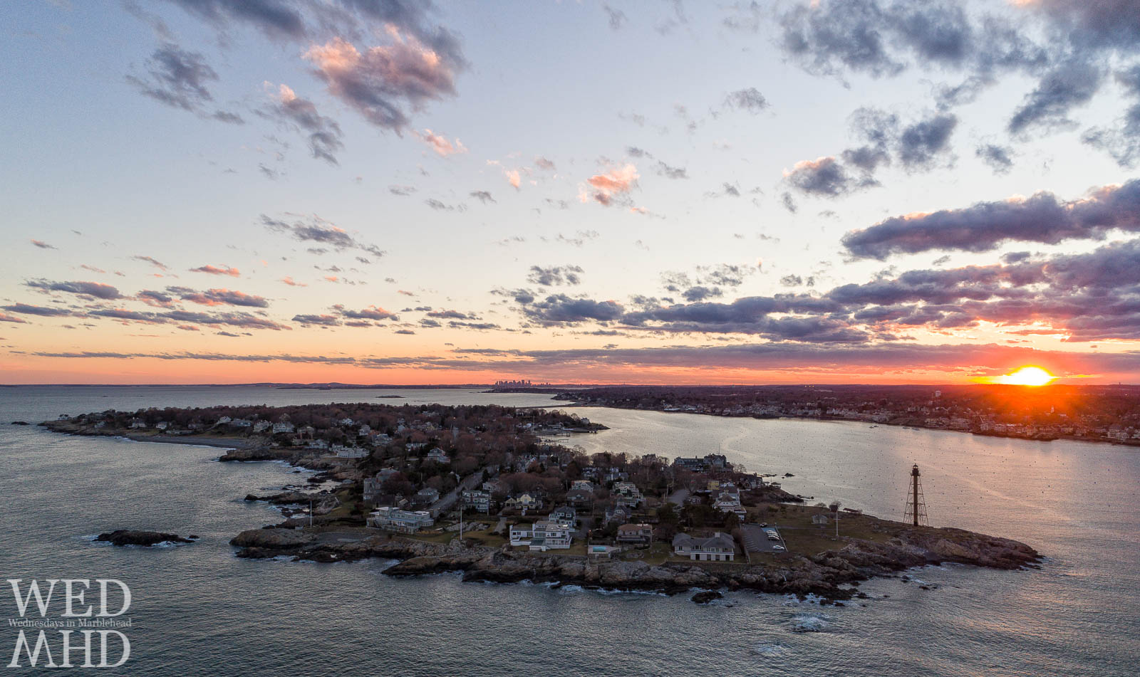 Sunset's last light on Marblehead Neck is captured from 300 feet over Chandler Hovey Park with the Boston Skyline visible in the distance