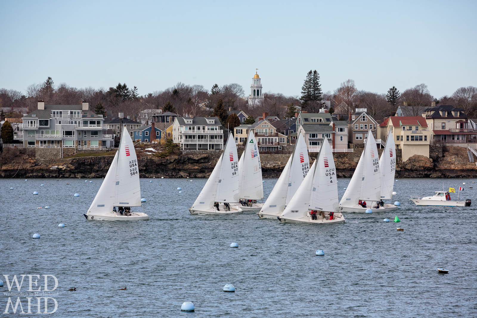 Frostbile sailing takes place in Marblehead Harbor each Winter and is captured here with the boats racing by Old North Church