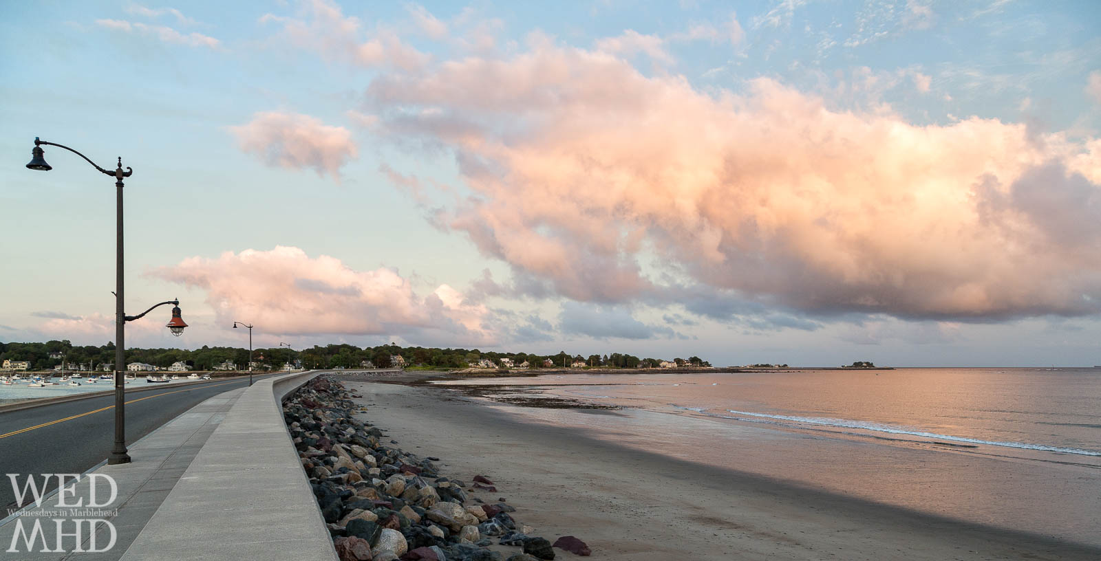 The causeway curves to meet the light of a September sunset reflecting off a cumulous cloud and the still waters below