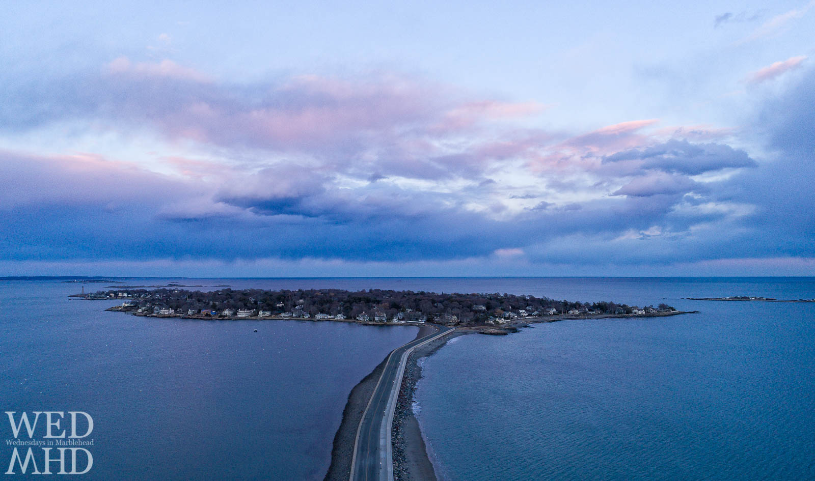 Aerial view of sunset on the neck captured from above the causeway on a early March evening