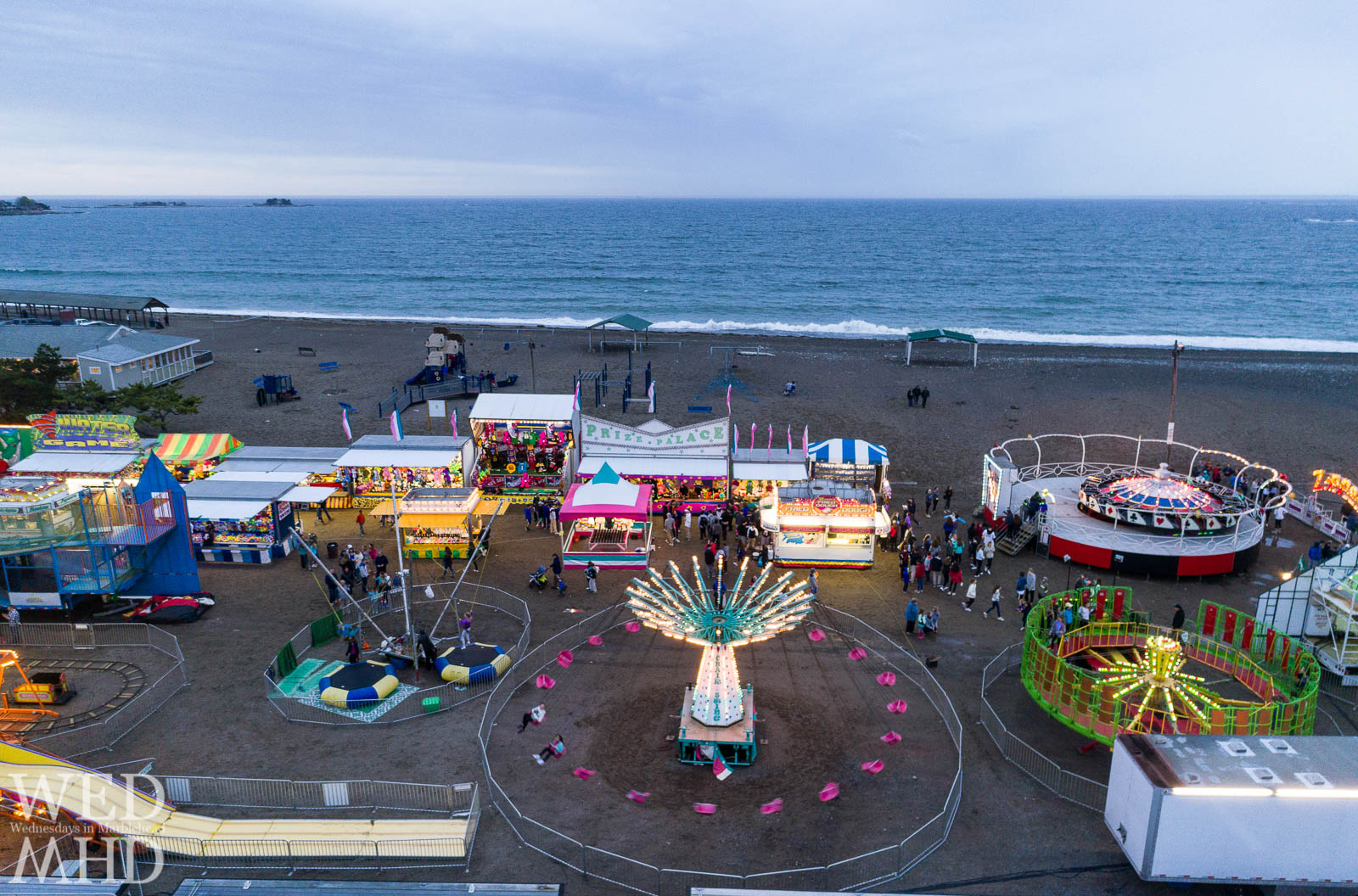 The annual Marblehead carnival by the sea is captured in full swing as kids of all ages explore rides and games along Devereux Beach