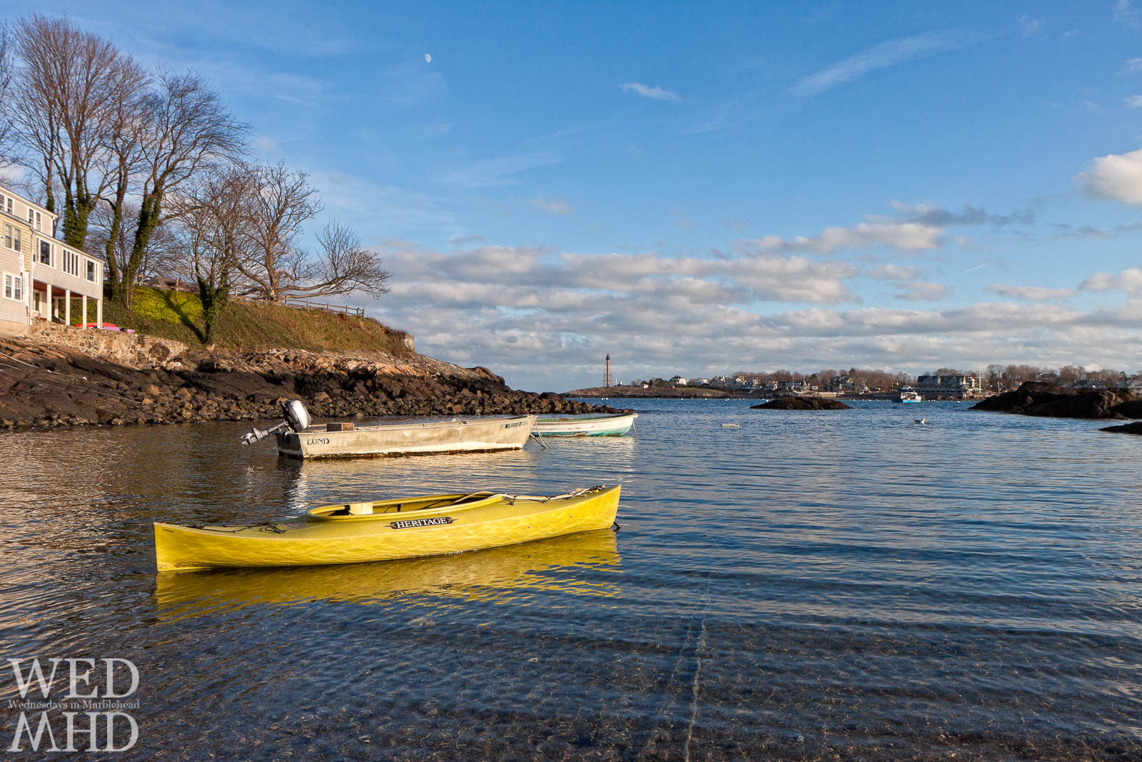 A kayak reflects afternoon light at Fort Beach signaling a good day for a row through the harbor