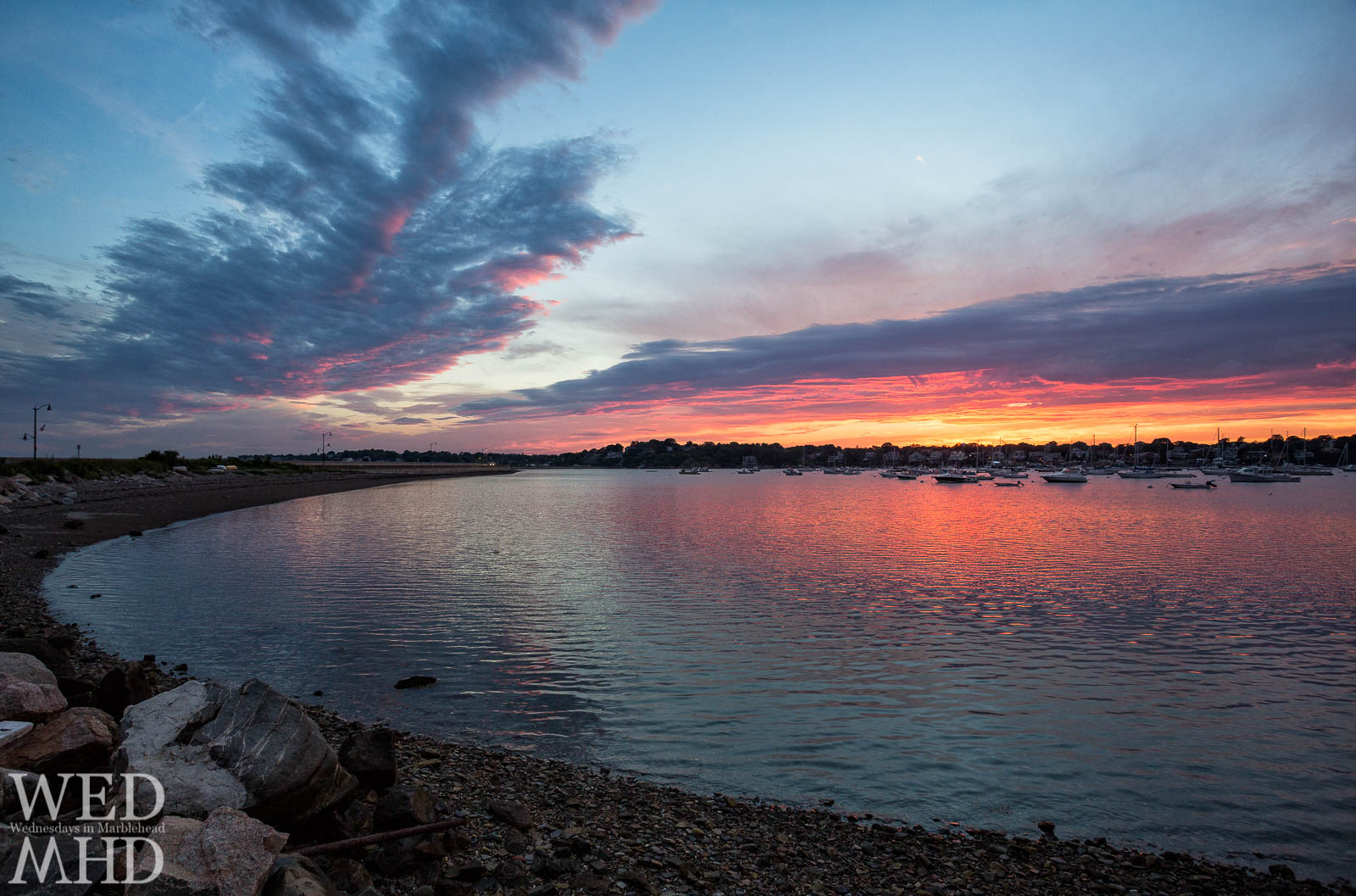 The end of a Summer sunset reflects off a small beach on Marblehead Neck.  This section of beach seems to be a continuation of Riverhead Beach.
