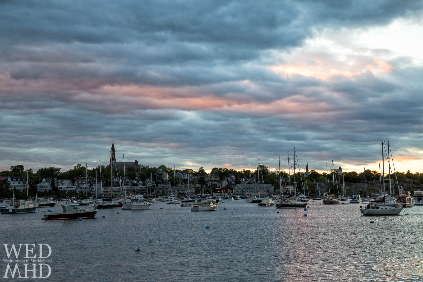 A Marblehead sunset captured from Parker Lane is compared to one shot from the air on an early June evening
