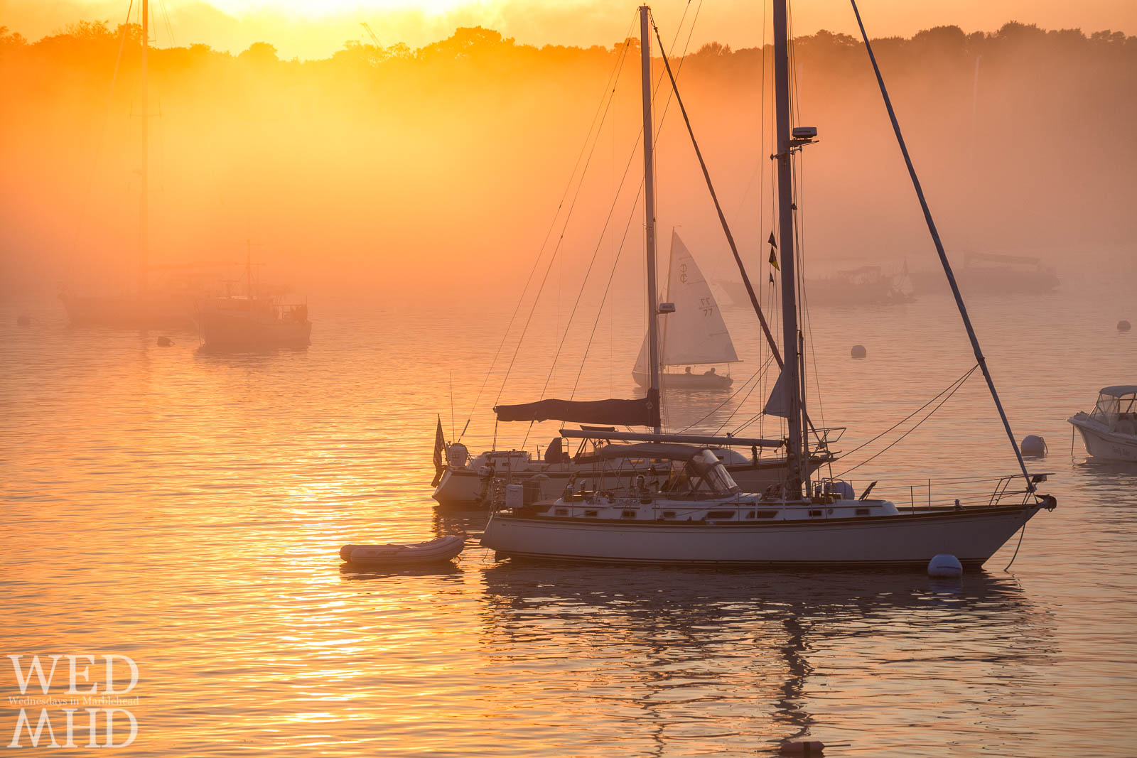 Summer fog takes hold of Marblehead Harbor at sunset on a warm Summer evening