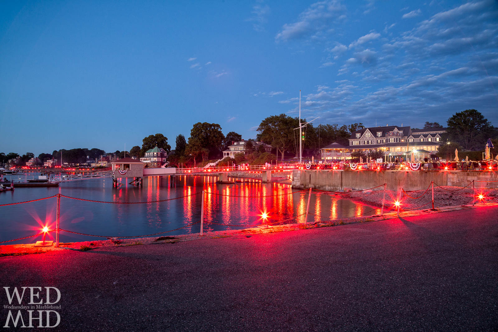 Lighting up the Eastern Yacht Club  with red flares during the annual Harbor illumination as part of the July 4th festivities in Marblehead