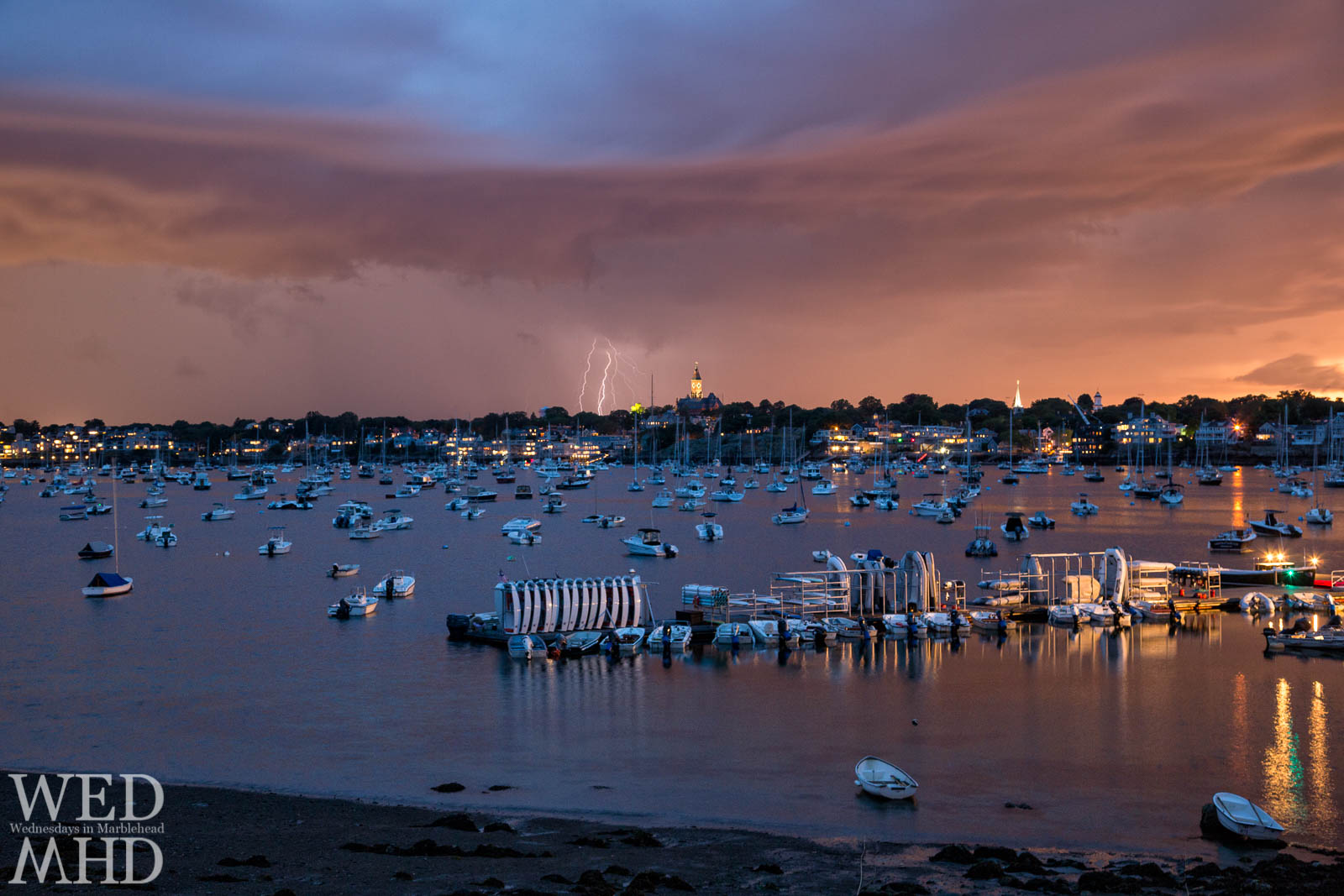 Strings of lightning captured during a storm showcase Mother Nature's fireworks against Abbot Hall and Marblehead Harbor