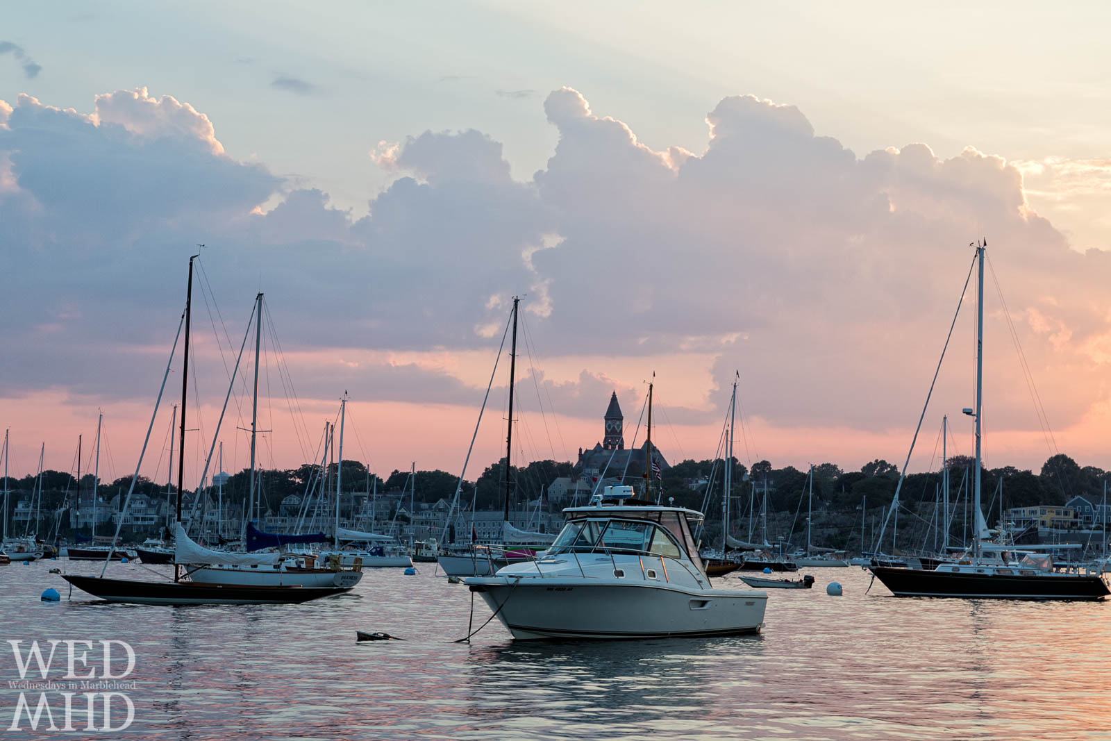 An impromptu harbor tour takes place on a mid-July evening with endless views of boats on their moorings and great light in the sky reflecting in the still waters