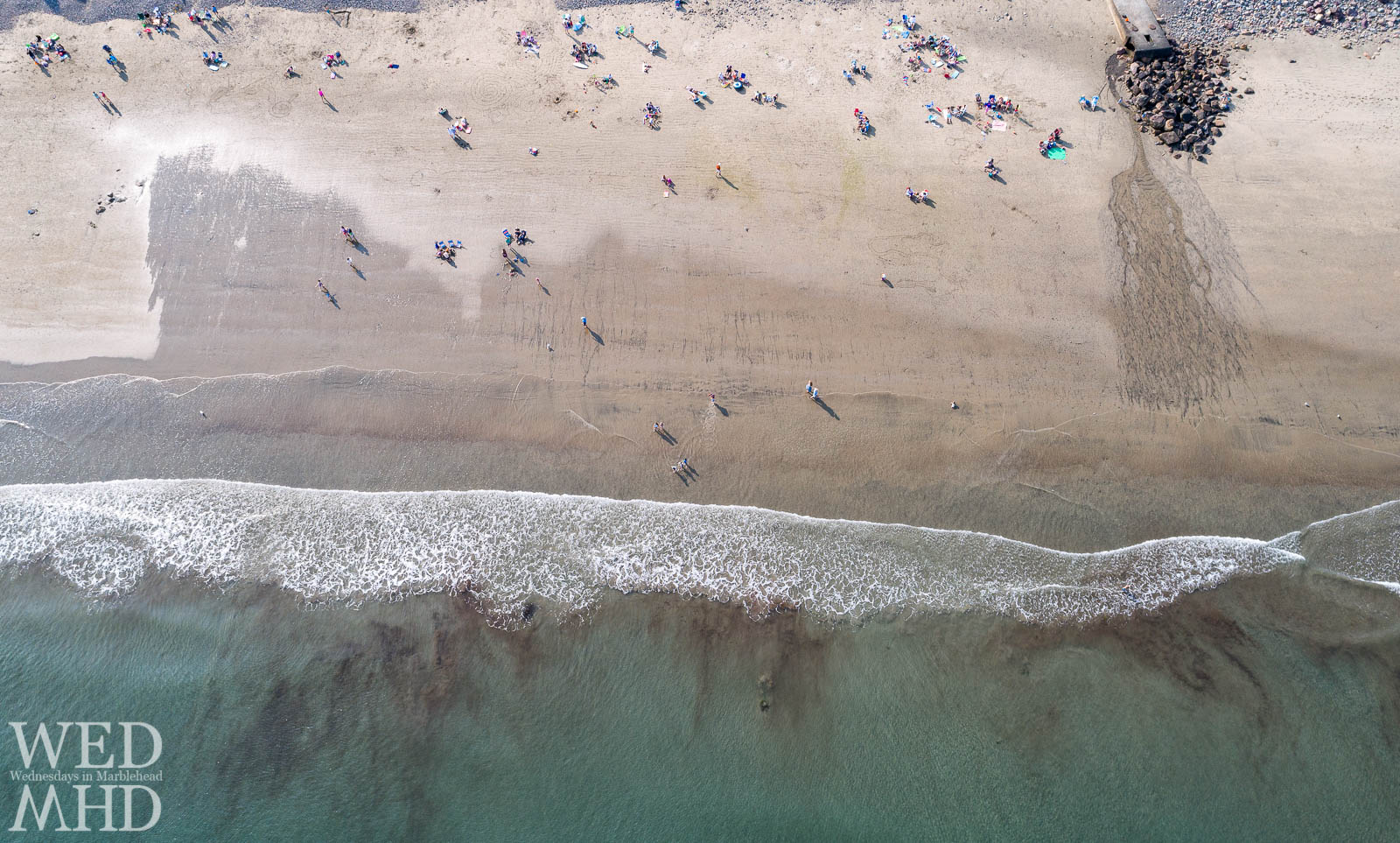 A birds eye view of Preston Beach reveals smooth sand and long shadows cast by the afternoon sun