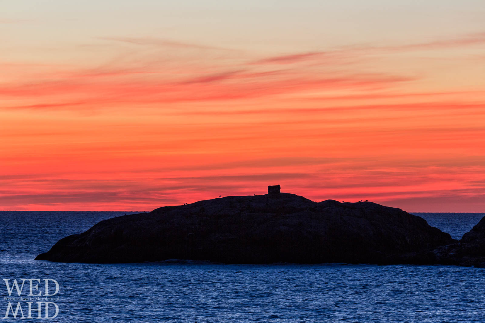 A red sky in morning over Marblehead Rock is a sure sign of inclement weather as the old saying goes
