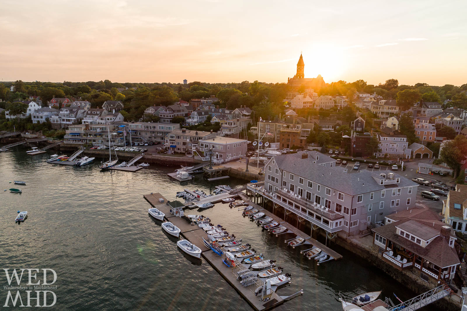 While high above the Boston Yacht Club, the sun sets behind Abbot Hall sending out rays of light over the BYC