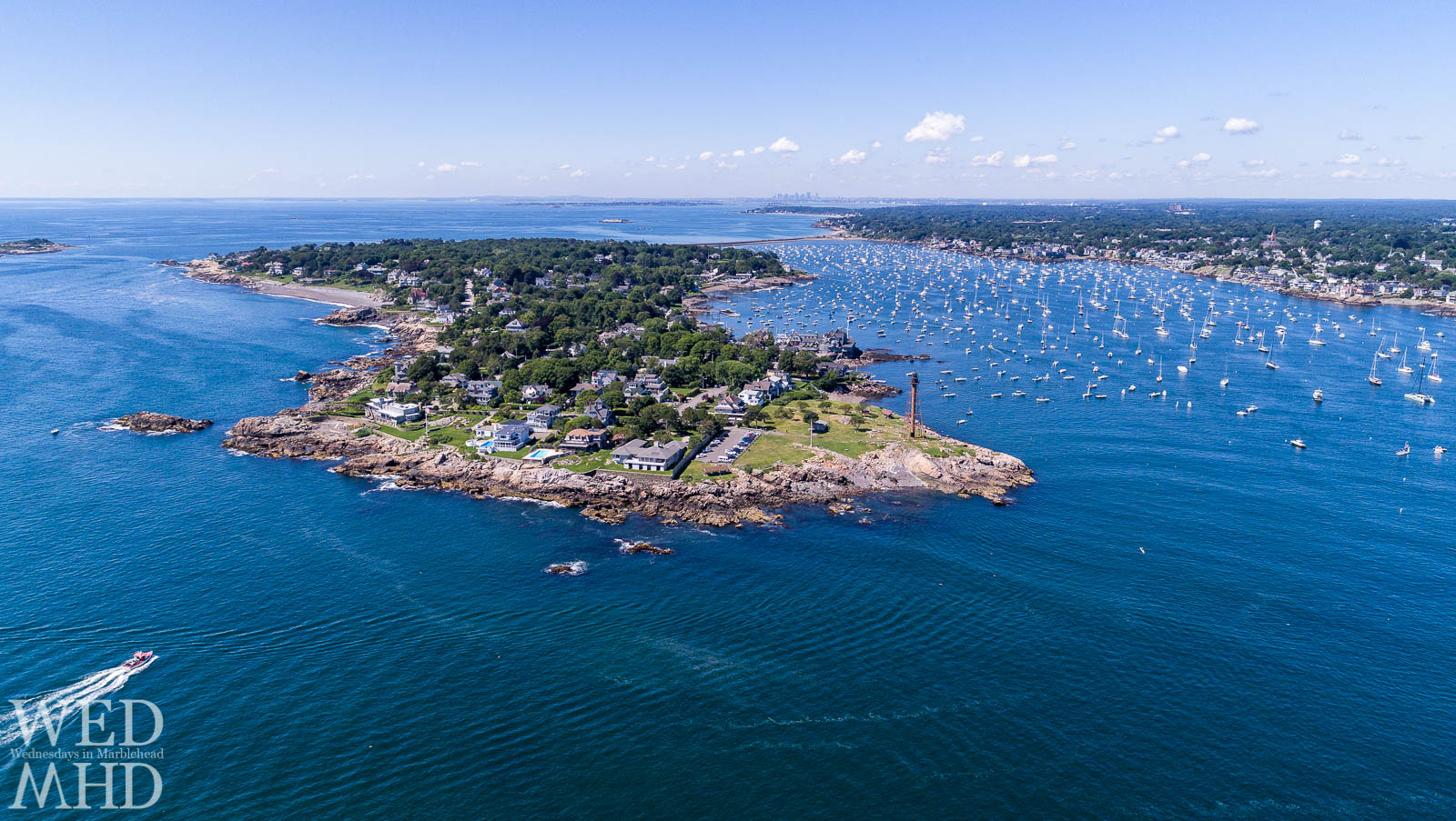 A boat approaches the Neck while coming home to Marblehead on a beautiful and warm Summer day