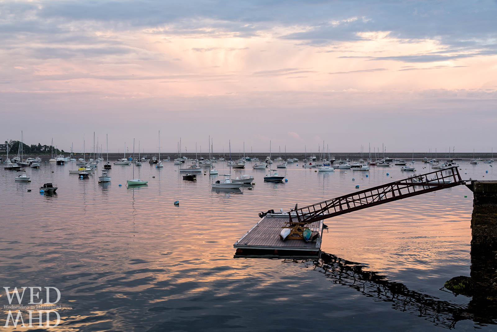 At low tide and the right angle this small dock seems to be floating on sunset at Ladys Cove in Marblehead