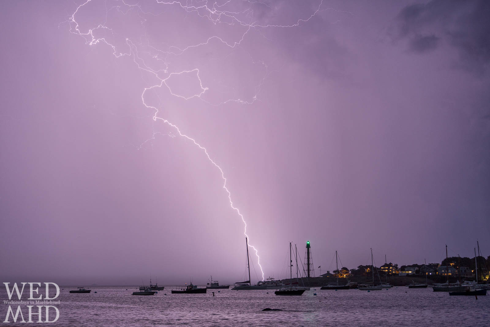A large bolt of lightning strikes Marblehead Light and Chandler Hovey Park as a fast lightning storm moves over town