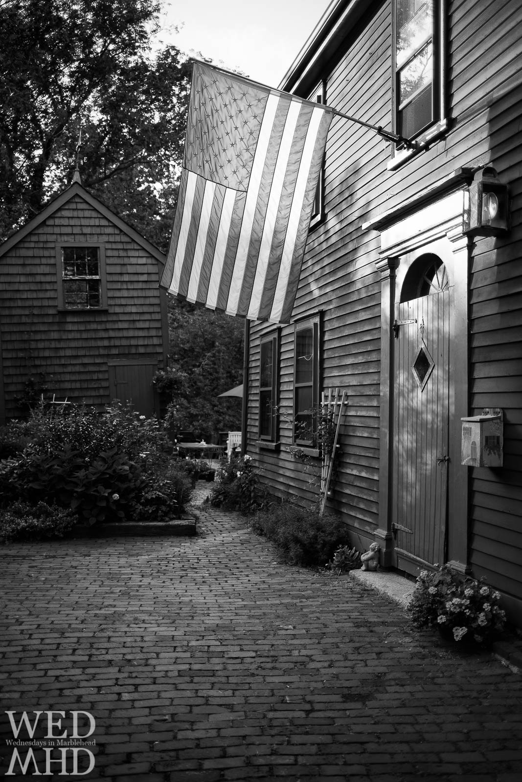The flag hangs proudly above this house in historic downtown as seen on a Marblehead Walking Tour with Bette Hunt