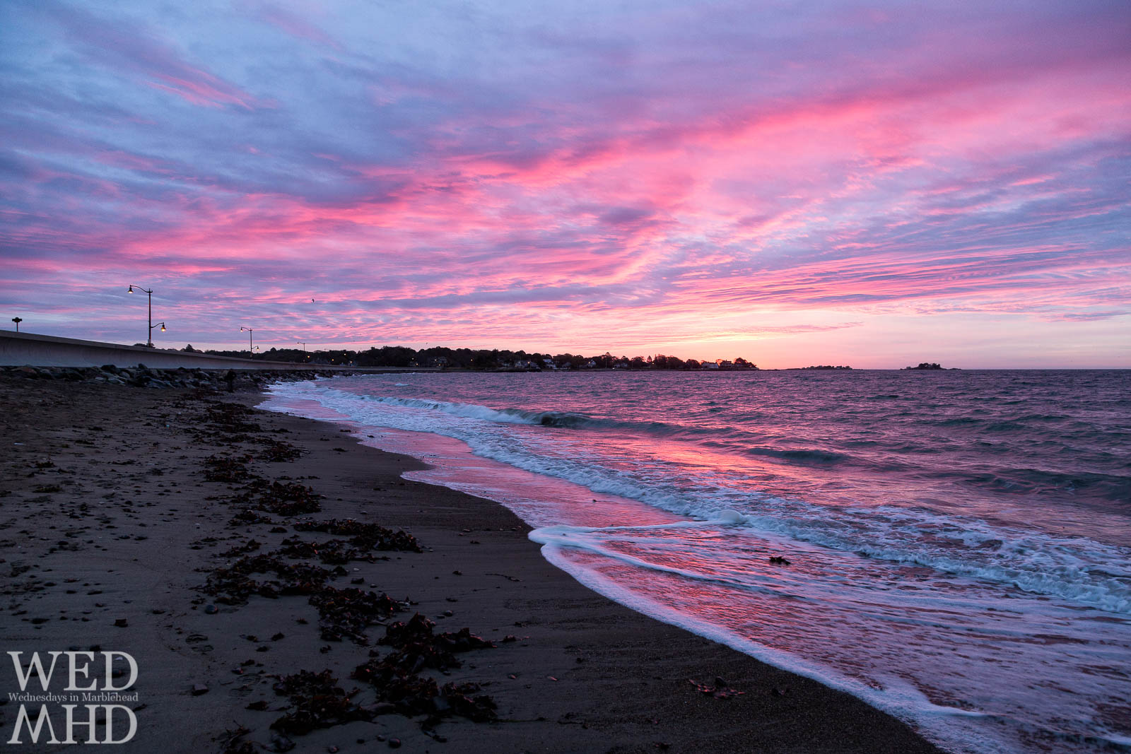 Devereux beach creates the backdrop for this dawn before the storm as waves reach shore and reflect the morning light ahead of an October shower