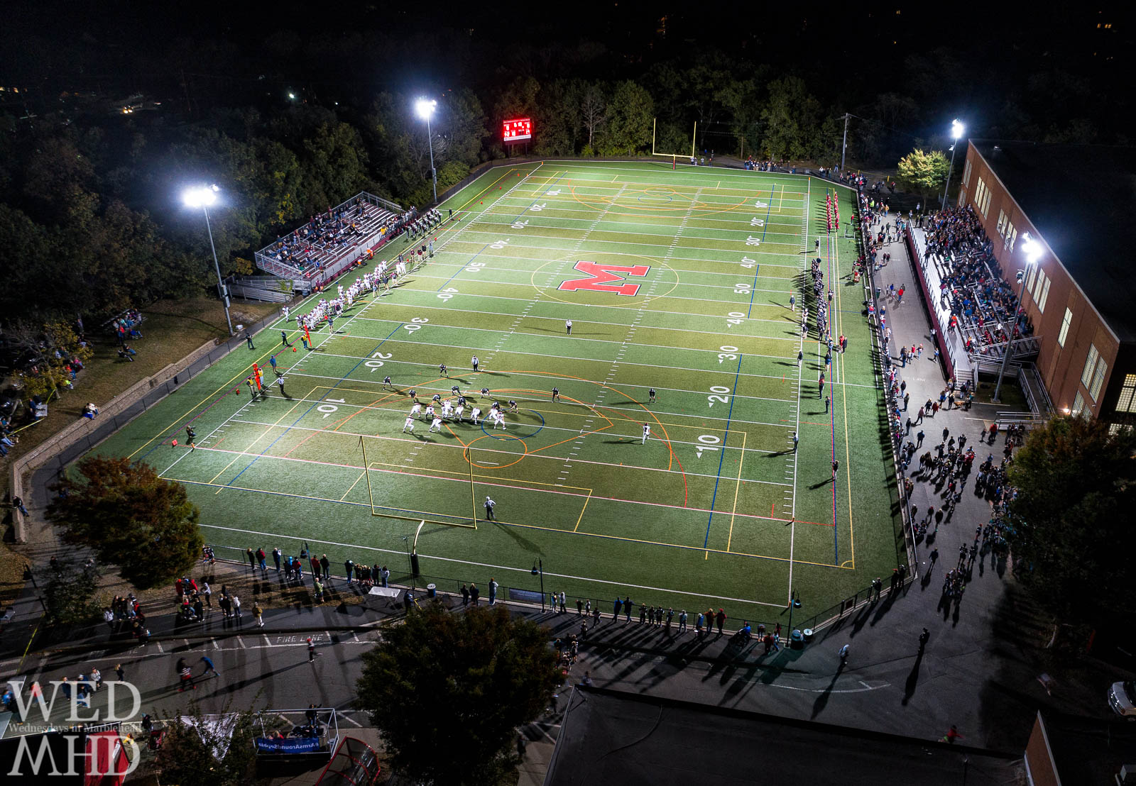 Friday night lights shine over the Marblehead High School football team as they play a home game against Gloucester. The Marblehead Magicians went on to win and maintain an undefeated season.