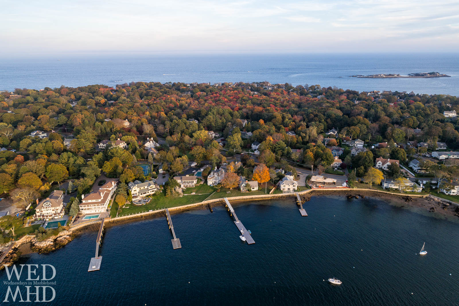 An aerial view of Marblehead Neck highlights changing colors and spots of foliage on an October afternoon