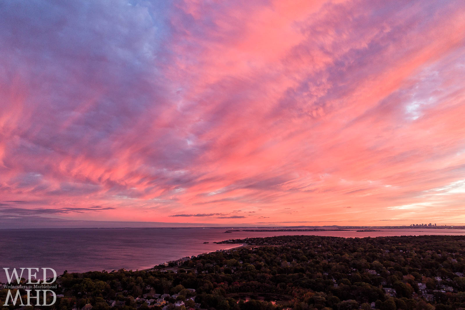 As pink light exploded in the sky, I took the drone up for a quick sunset flight directly over my house in Marblehead catching this view of the Boston skyline