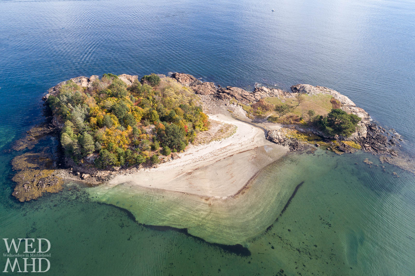 An overhead view of the beach at Brown's Island seen on a late October afternoon as leaves show shades of fall color