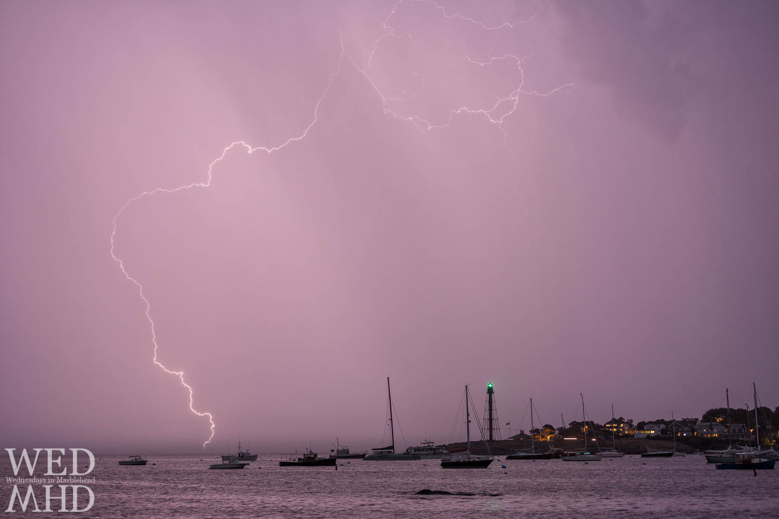 Lightning strikes twice during an active storm over Marblehead with this large bolt touching the water near Chandler Hovey Park