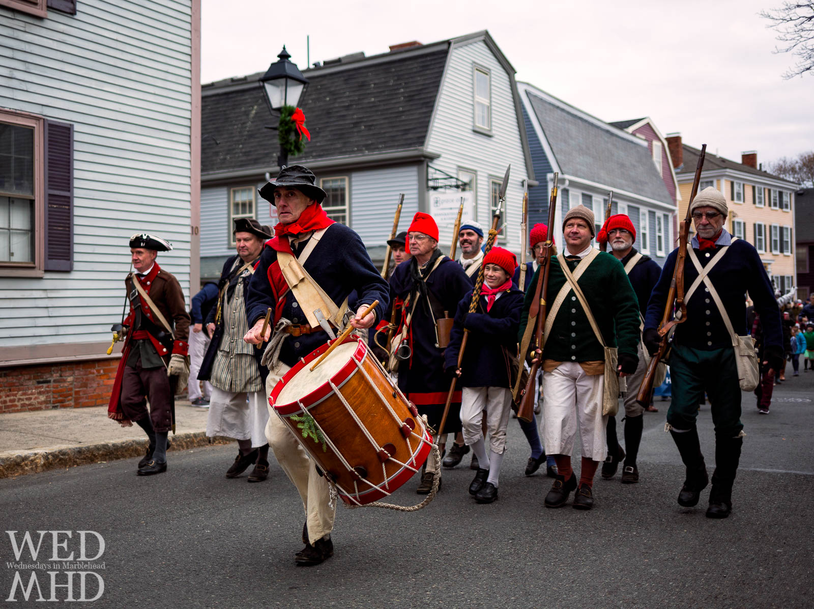 Glover's Regiment leads the annual Marblehead Christmas walk parade with everyone marching to the beat on State Street before turning on to Washington and continuing through town.