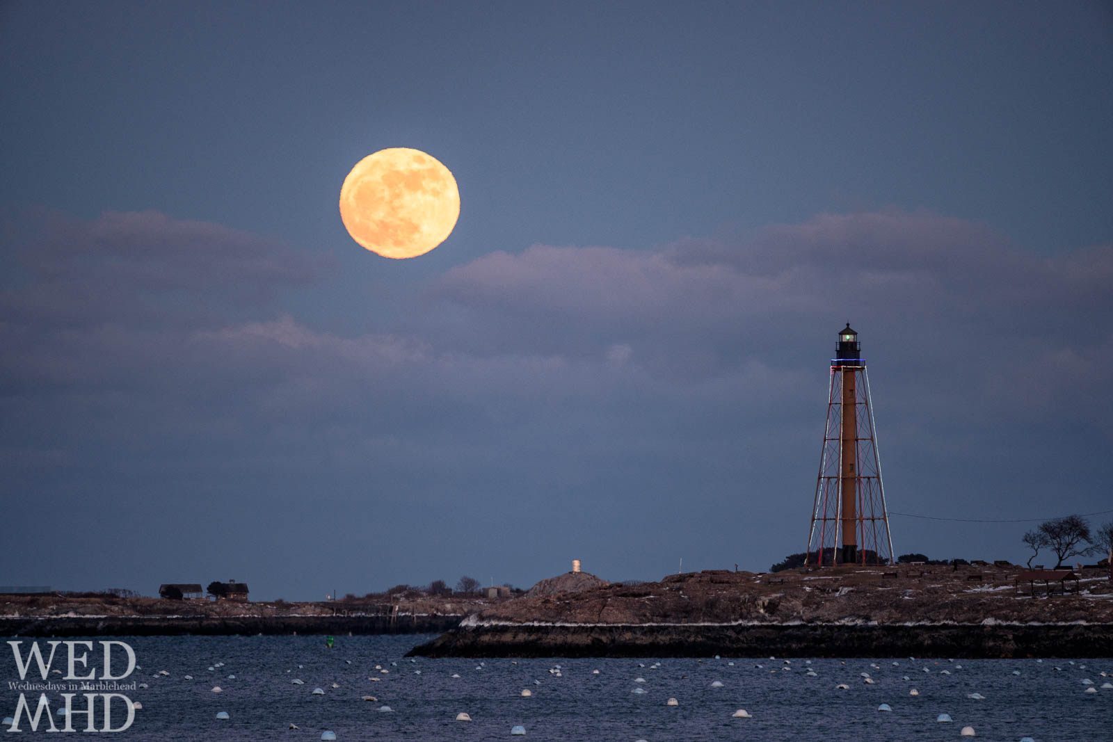 The New Years Supermoon rises over Chandler Hovey Park and Marblehead Light on an arctic start to 2018.