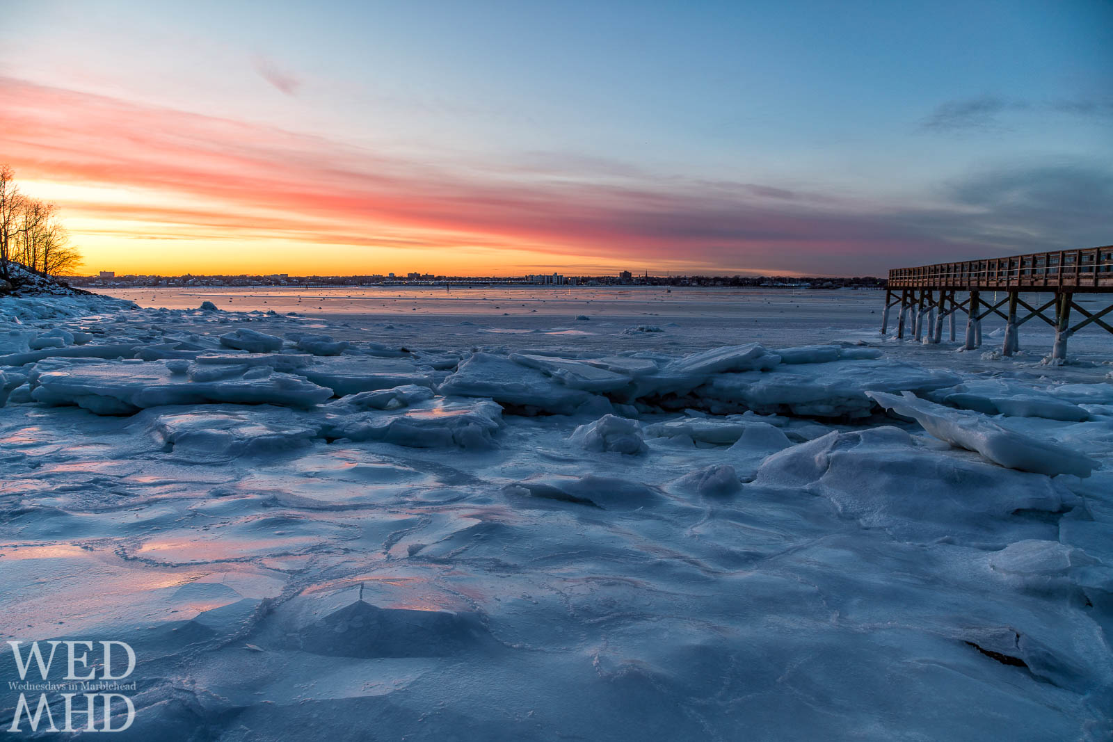 Pancake ice forms at Stramski Beach during a long spell of arctic conditions. The ice perfectly reflects the light of sunset.