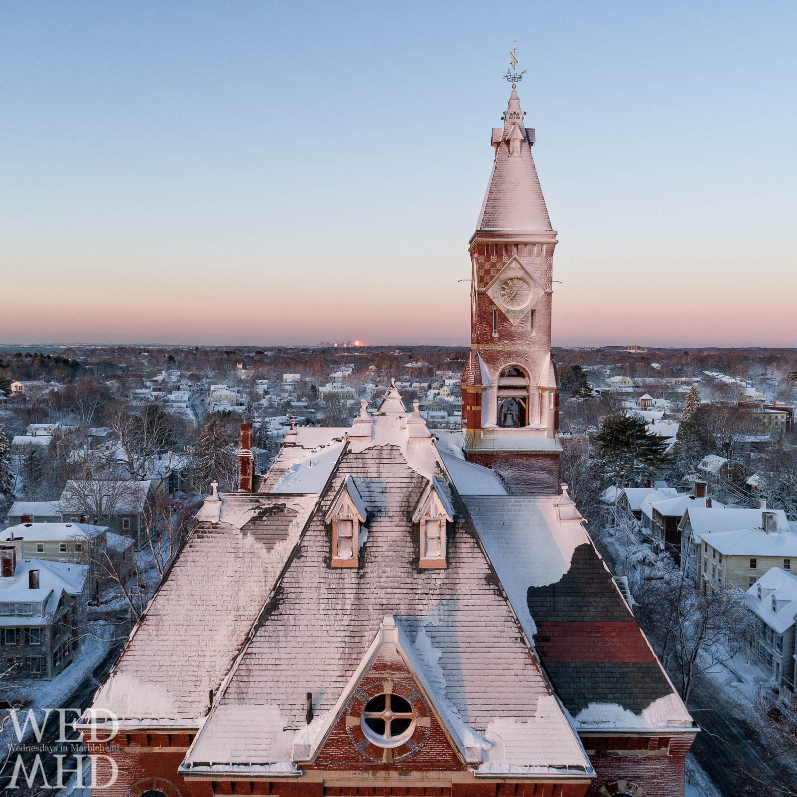 Abbot Hall is seen in this aerial image captured just after sunrise. A mid-March storm left the building caked with snow.