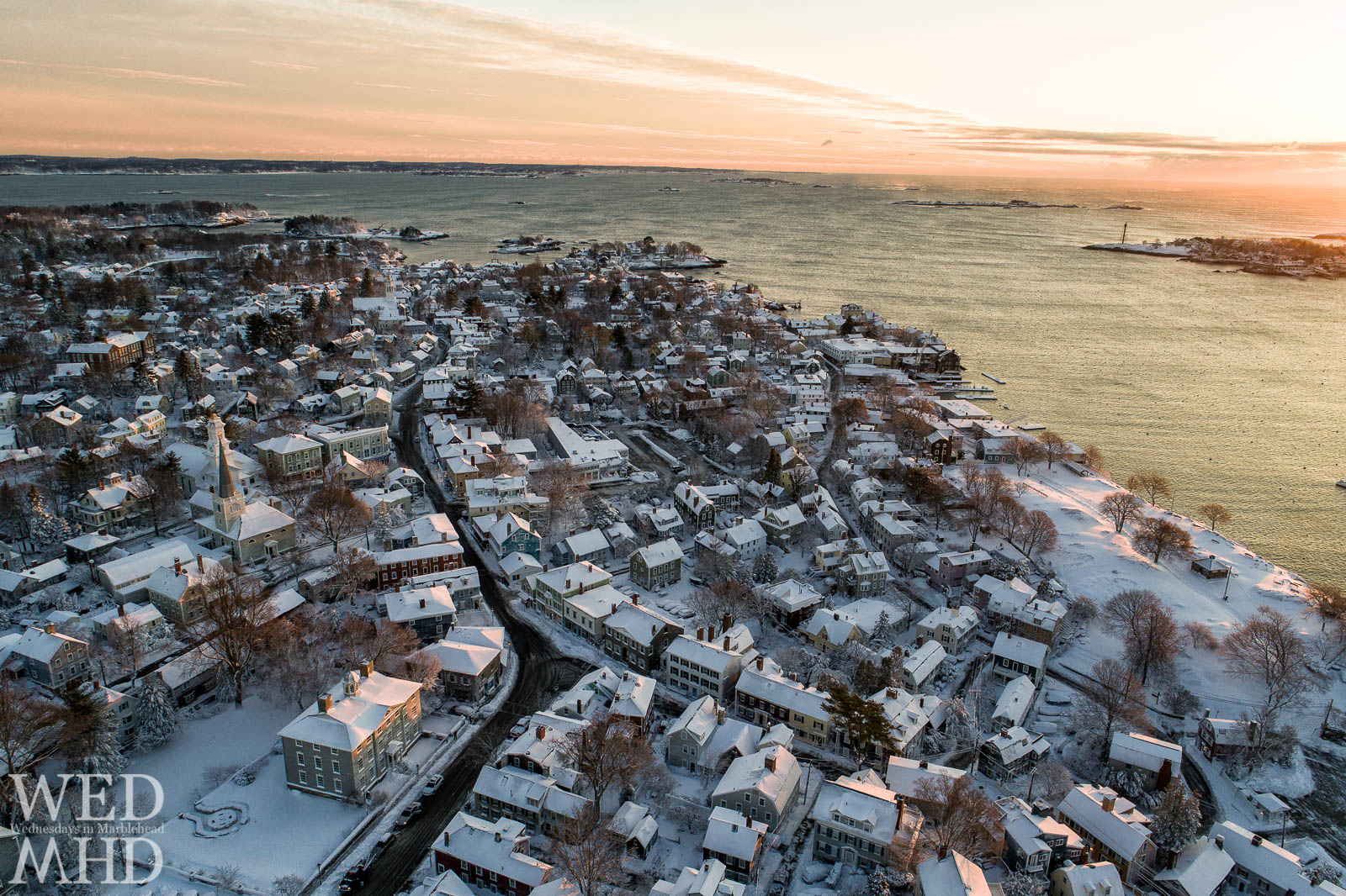 First light of morning shines over historic downtown Marblehead and the harbor with a fresh coat of snow deposited by the latest Nor'Easter