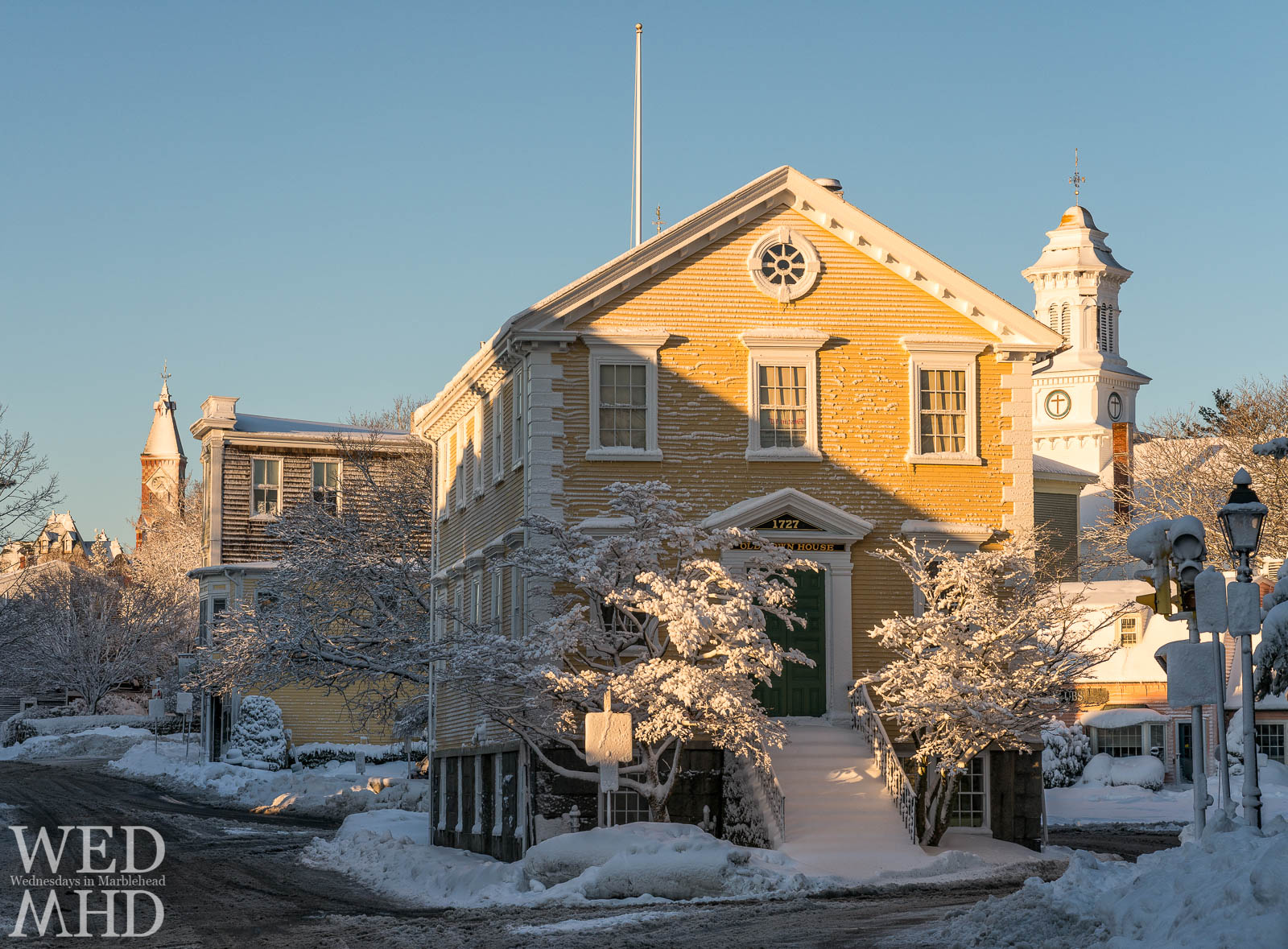 Old Town House, Abbot Hall and Grace Community Church catch the first light on Washington Street after a March blizzard