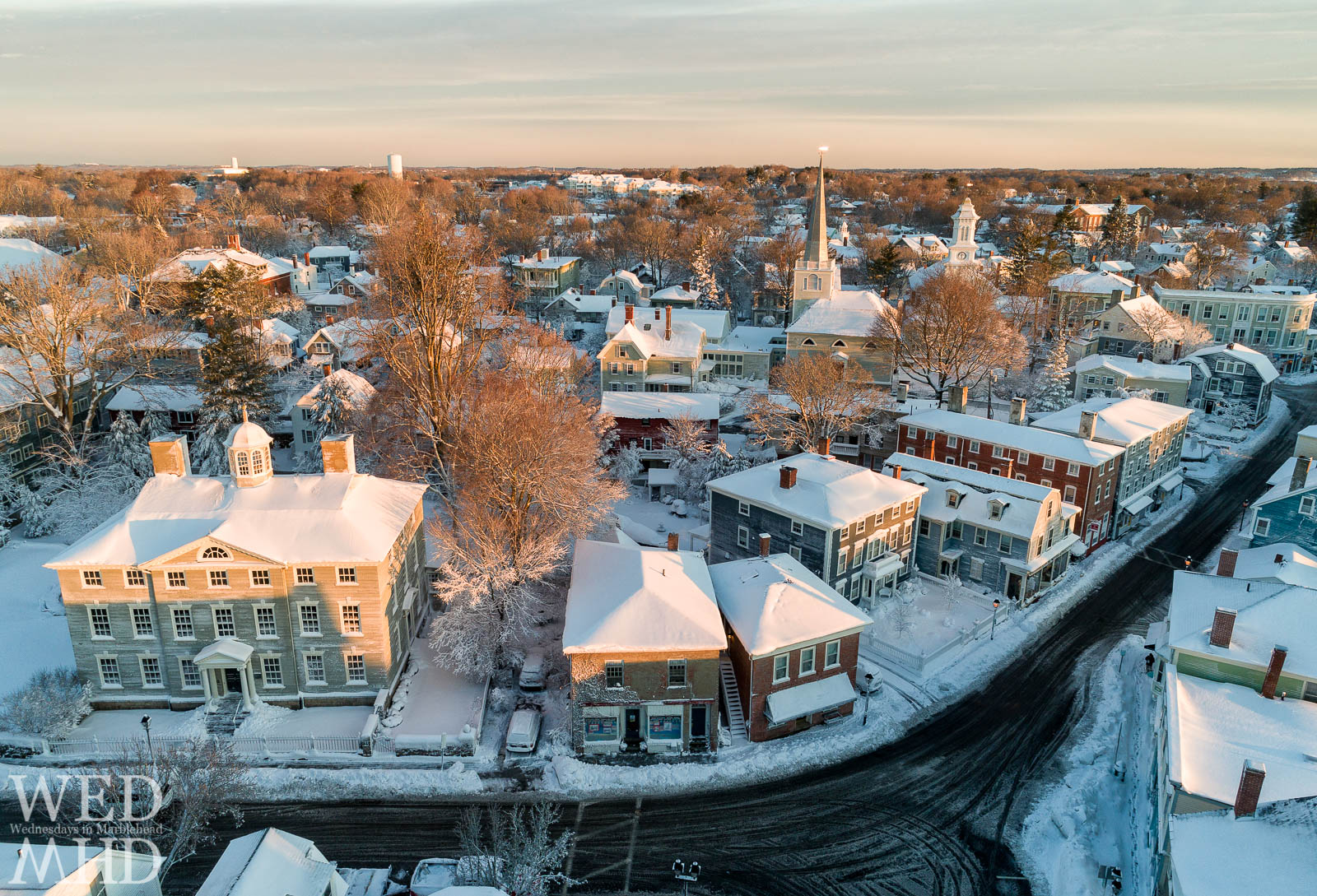 The Lee Mansion, St Michaels Steeple and numerous examples of classic architecture are seen in this aerial view of historic downtown Marblehead after a blizzard